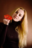 Blonde posing with a red flower Stock Photos