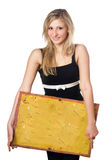 Blonde posing with yellow vintage board Royalty Free Stock Images