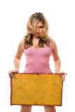 Blonde posing with yellow vintage board Royalty Free Stock Photo