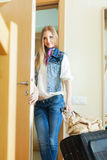 Blonde positive woman with luggage Royalty Free Stock Photography