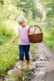 Blonde preschool little girl picking fresh edible mushrooms Stock Photo