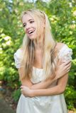 Blonde pretty bride laughing Royalty Free Stock Photography