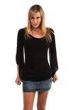 Blonde. Pretty petite blonde woman in black long sleeved blouse Royalty Free Stock Photography
