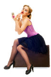 The blonde pretty woman waits, sits on a suitcase Stock Photography