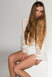 Blonde. Pretty young Russian blonde in a white knit sweater Royalty Free Stock Photo