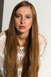 Blonde. Pretty young Russian blonde in a white knit sweater Royalty Free Stock Photography