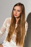 Blonde. Pretty young Russian blonde in a white knit sweater Royalty Free Stock Image