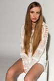 Blonde. Pretty young Russian blonde in a white knit sweater Stock Photo