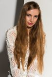 Blonde. Pretty young Russian blonde in a white sleeveless top Royalty Free Stock Photos