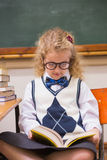 Blonde pupil reading a book Stock Image
