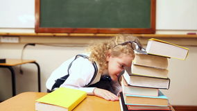 Blonde pupil using magnifying glass. In classroom at the elementary school stock footage