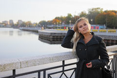 Blonde on quay Royalty Free Stock Photos
