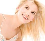 Blonde que mira para arriba Imagenes de archivo