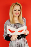 Blonde reading a card Stock Image