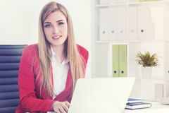 Blonde real estate agent in office Royalty Free Stock Photos