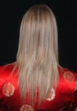 Blonde On Red. Rear view of blonde female wearing red Chinese Blouse Stock Photography
