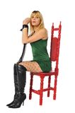 Blonde in a red chair Stock Photo