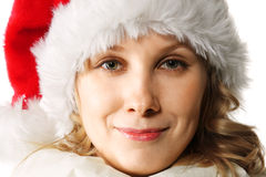 Blonde in red Christmas cap Stock Images