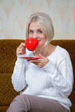 Blonde with a red cup Royalty Free Stock Image
