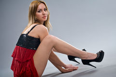 Blonde in red dress Royalty Free Stock Image