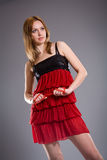 Blonde in red dress Stock Photography