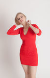 Blonde in a red dress Royalty Free Stock Image
