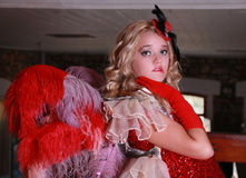 Blonde in red dress with feathers Royalty Free Stock Image
