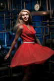 Blonde in a red dress Stock Photo