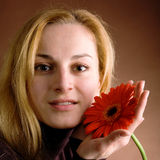 Blonde with a red flower Royalty Free Stock Image