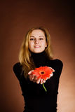 Blonde with a red flower Royalty Free Stock Photo