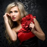 Blonde in a red gown Stock Photography