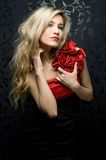 Blonde in a red gown Royalty Free Stock Photography