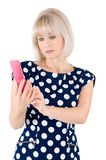 Blonde with a red mobile phone Stock Images