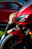 Blonde and red motorcycle Stock Photography