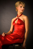 Blonde in red portrait Stock Photos