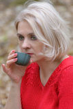 Blonde in a red pullover Royalty Free Stock Image