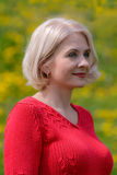 Blonde in a red pullover Royalty Free Stock Photo