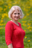 Blonde in a red pullover Stock Images