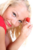 Blonde in red showing strawberry Stock Photos