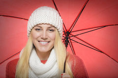 Blonde with red umbrella Royalty Free Stock Photo