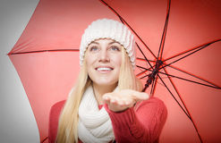Blonde with red umbrella Stock Images