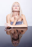 Blonde and reflecting table Royalty Free Stock Photography