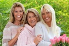 Blonde reife Frau drei Stockbilder