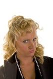 Blonde riccio con lo sguardo di disapprovazione Immagini Stock