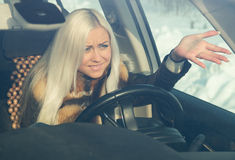Blonde in road angry Stock Images