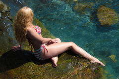 Blonde on a rock Royalty Free Stock Photo