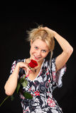 Blonde with rose. Royalty Free Stock Images