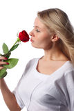 Blonde with rose. Royalty Free Stock Photos