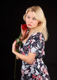 Blonde with rose. Royalty Free Stock Photo