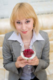 Blonde with rose in stemware Royalty Free Stock Photo